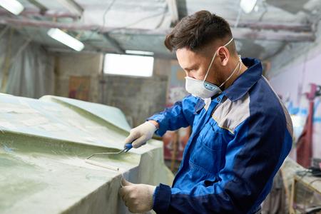 Man Repairing Motorboat