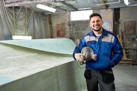 Boat Repairman Posing in Workshop