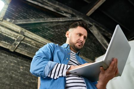 Handsome Mature Man Using Laptop Banco de Imagens