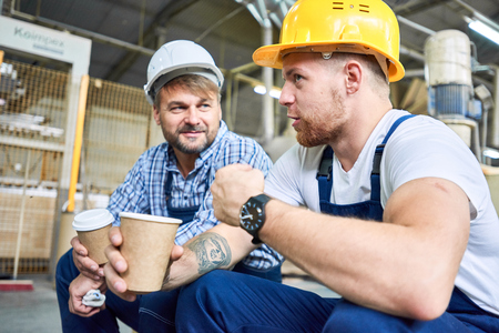 Construction Workers Chatting on Coffee Break