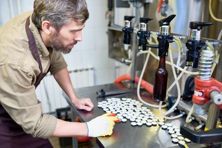 Beer Factory Worker Using Equipment