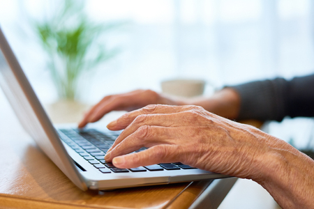 Elderly Woman Using Laptop Stock Photo