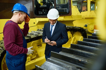 Giving Tour of Modern Factory Stock Photo