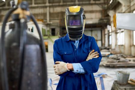 Female Welder Posing at Factory Stock Photo
