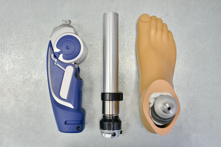 Disassembled Prosthetic Leg on Doctors Table Фото со стока