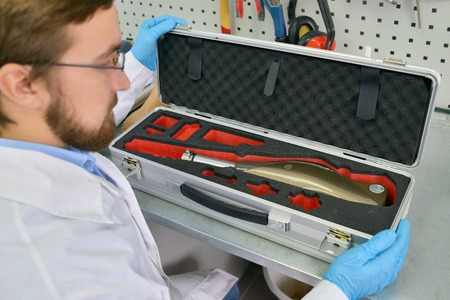 Prosthetics Technician Packing Prosthetic  Leg