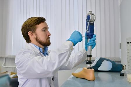Prosthetist Repairing artificial Limb