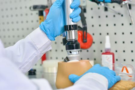 Prosthetist Assembling Artificial Leg Close Up