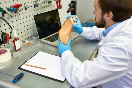 Doctor Working with Prosthetics in Office Stock Photo