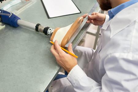 Engineer Making Prosthetic Leg 写真素材