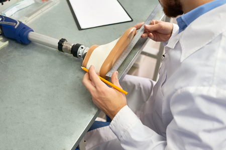 Engineer Making Prosthetic Leg Stock Photo