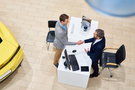 Man Buying Car in Showroom