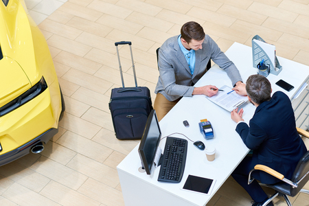 Businessman Signing Car Lease Agreement Stockfoto