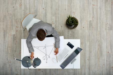 Dark-Haired Architect at Work