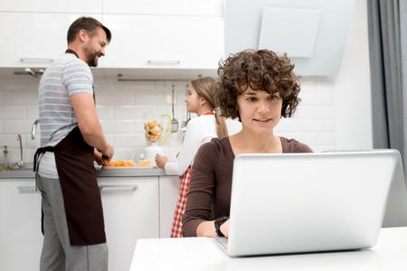 Loving Family Spending Morning in Kitchen