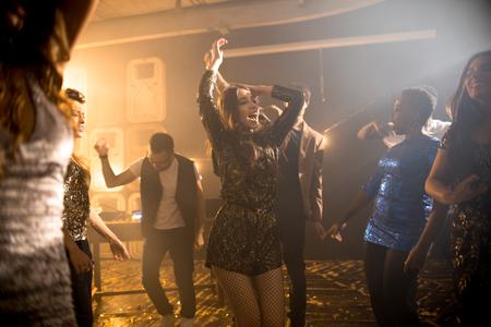 Young Woman Dancing in Club