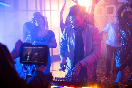 DJ at Gig in Nightclub