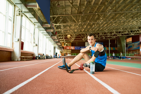 Handicapped Sportsman Sitting  on Running Track