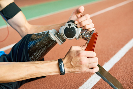 Disabled Sportsman Fixing Artificial Limb