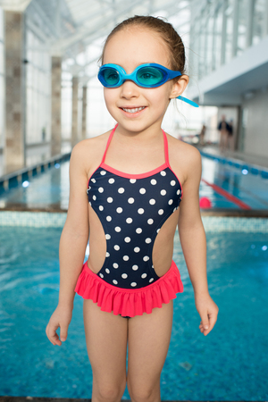 Pretty Little Swimmer with Wide Smile Stock Photo
