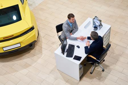 Businessman Buying Car in Showroom