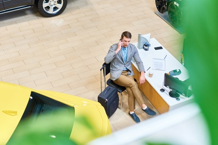 Client in Car Showroom