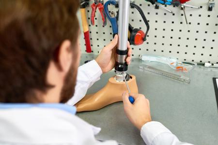 Prosthetist Assembling Artificial Leg