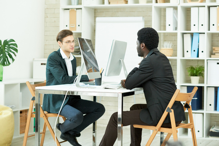 Young Professionals Working in Office Stock Photo - 94591792
