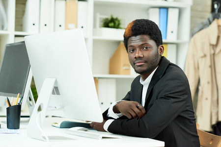 African-American Professional Posing in Office Stock Photo