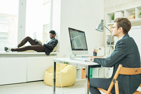 People in Modern Comfortable Office