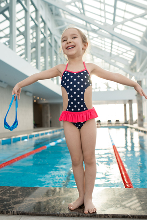 Happy Little Girl in Swimming Pool