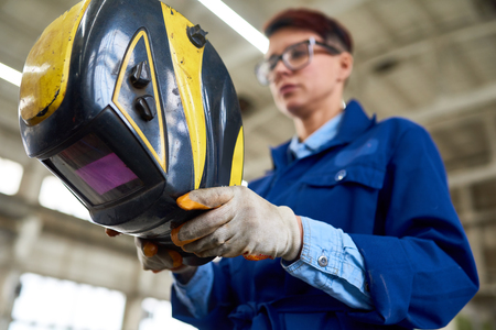 Female Welder at Industrial Plant Stock Photo