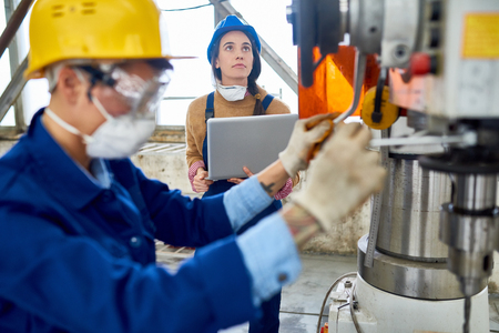 Female Engineer Working at Factory