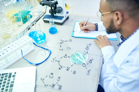 Middle-Eastern Scientist Working in Lab