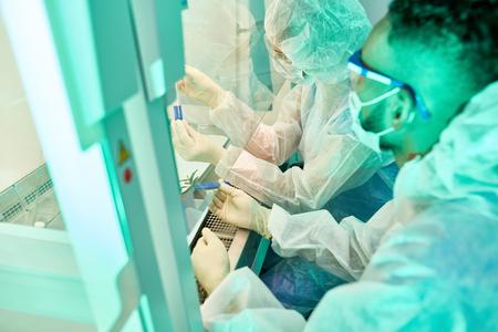 Scientists in Biohazard Lab