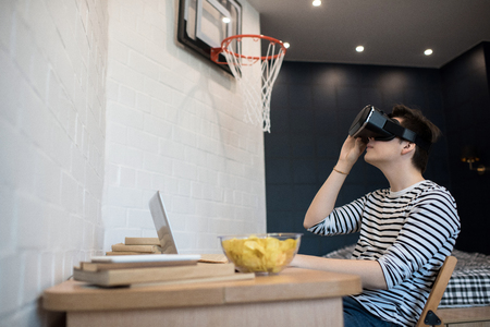 Young Man Playing VR Game