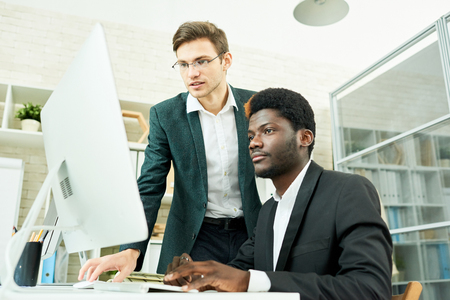 Two Young Businessmen Planning Startup