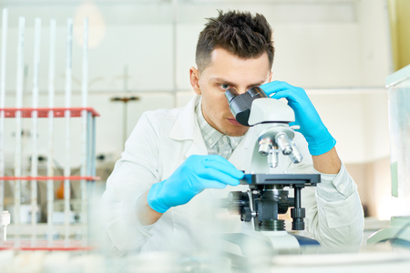Concentrated Researcher Using Microscope Stok Fotoğraf - 96013445