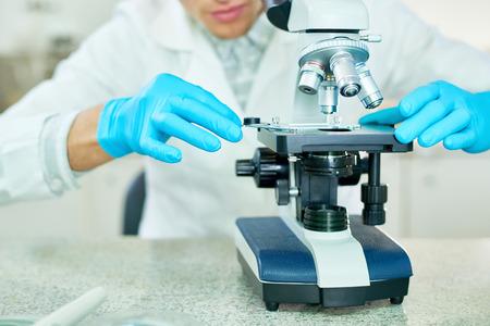 Examining Sample with Microscope Stok Fotoğraf