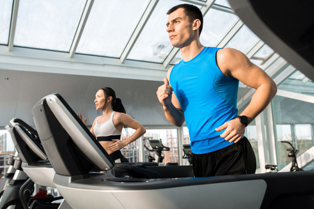 Clients Running on Treadmills Stockfoto