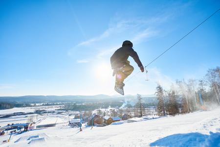 Snowboarder Jumping High Zdjęcie Seryjne