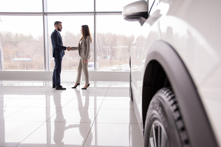 Car Salesman Shaking Hands with Customer Stock Photo