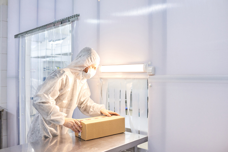 Worker Packing Medicinal Products