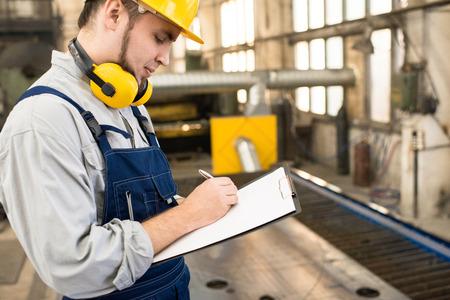 Bearded Technician Focused on Work Stock Photo
