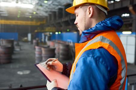 Bearded Worker Taking Inventory