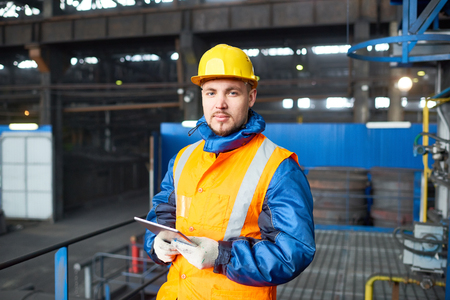 Handsome Worker Using Digital Tablet Stockfoto