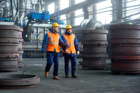 Two Technicians Walking Along Production Department