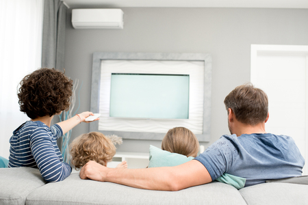 Family Watching TV, Back View Stock Photo