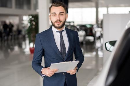 Successful Car Salesman in Showroom Stock Photo