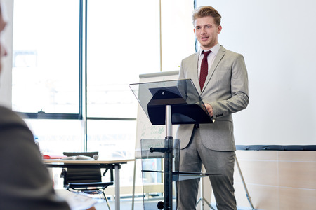 Confident Businessman Giving Speech